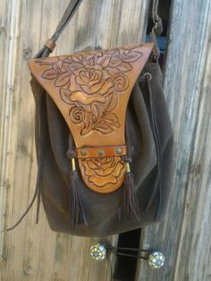 Hand tooled leather and suede bag
