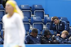 NAPPING ON THE JOB: Members of the grounds staff rested as France's Kristina Mladenovic played during the third round of the Aegon Classic tennis tournament in Birmingham, England. (Andrew Boyers/Action Images/Zuma Press)