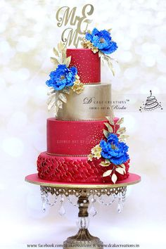 Red & Gold Wedding Cake with Royal Blue Flowers by D Cake Creations