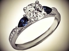 Cathedral Diamond Engagement Ring Blue Sapphire Pear Shape side stones