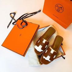 "👑 Hanna Isabelle 👑 on Instagram: ""For all of you who wanted to know what was inside the 🍊 bag - here you go! A pair of classic Oran slippers in gold leather with contrast…"" Replica Handbags, Handbags Online, Burberry, Gucci, Celine Bag, Prada Bag, Gold Leather, Dior, Slippers"