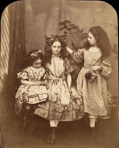 """solo-vintage: """" Lewis Carroll, 1863 Irene and Mary MacDonald were two of the five children of Scottish novelist and poet George MacDonald. Carroll was a friend of the family, and the children. Vintage Pictures, Old Pictures, Vintage Images, Old Photos, Time Pictures, Antique Photos, Lewis Carroll, Alice Liddell, Photo Post Mortem"""