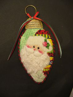 My first needlepoint project! Santa with curly beard