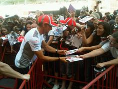 Jensen Button in Barcelona; these drivers are received as rock stars everywhere in the world but America