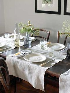 Landscape-Inspired    A motley assortment of vintage bentwood chairs surrounds an 18th-century oak table in this Rhode Island home's dining room. The linen runners are from a Vermont antiques shop.        Read more: Dining Room Decorating Ideas - Dining Room Decor - Country Living