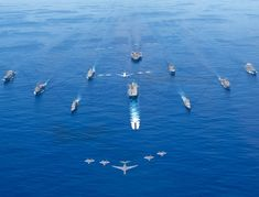 A pride inducing display of USA military power as Navy ships steam in formation on the Philippine Sea with Navy and Air Force aircraft flying above them in support of Valiant Shield 2020. Tactical Training, Rear Admiral, Command And Control, Air Force Aircraft, Military Training, Navy Ships, Pearl Harbor, Water Crafts