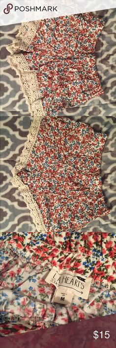 LA Hearts Women's Shorts LA hearts short summer shorts in a floral pattern. They have a lace trim on the bottoms. Only worn once and are in perfect condition! La Hearts Shorts