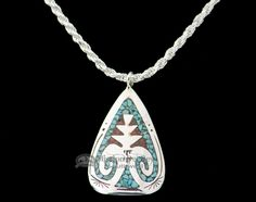 This is an authentic Native American silver jewelry pendant with an included silver chain necklace. Made by hand, silver Indian jewelry is a traditional handcraft of American Indians of the southwest.