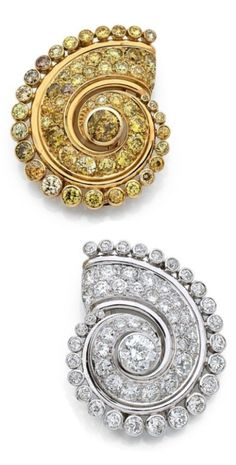 A pair of Art Moderne 'Spire' clip brooches, by Suzanne Belperron, 1938-39. One composed of white gold, platinum and brilliant-cut diamonds, the other of yellow gold and yellow diamonds. With maker's mark for Groené & Darde. #Belperron #ArtModerne #brooch
