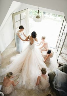 39 Getting-Ready Wedding Photos Every Bride Should Have: #6. If your dress has a train, let your girls show it off