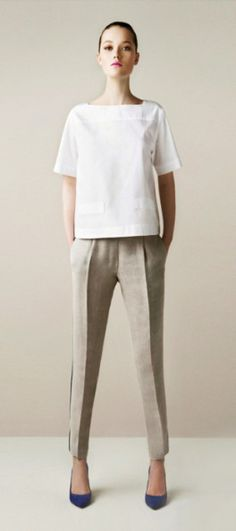 Boxy top on tailored, cropped pants.