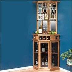 """A corner bar for the kitchen would be sweet (if not at the house now, then when we move).  I would like to put a kegerator in the bottom for Yuengling, and then have the cabinet on top for the rest of the """"bar"""" stuff."""