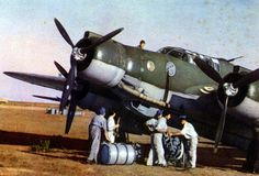 """Aircraftmen refueling, with drum, pump and hosepipe, an Italian Regia Aeronautica's bomber Cant-Z-1007bis """"Alcione"""" on an Italian airport. Note the livery, completely in dark olive drab, of aircraft. Italian Air Force, Italian Army, Ww2 Pictures, Ww2 Photos, Ww2 Aircraft, Military Aircraft, Ww2 Planes, Aviation Art, Luftwaffe"""