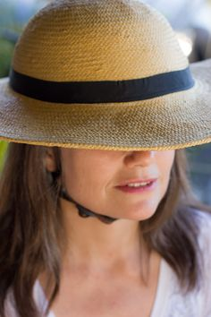 The Charleston - A bicycle helmet cover with a rounded crown, wide brim, and black ribbon by BandBox Helmets.