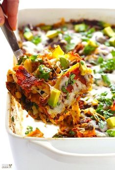"""This chicken enchilada casserole recipe (a. """"stacked chicken enchiladas"""") is simple to make, gluten-free and vegan-adaptable, and CRAZY delicious! I made the special enchilada sauce but you need to double it. Mexican Dishes, Mexican Food Recipes, Recipes Dinner, Dinner Ideas, Mexican Drinks, Clean Eating Recipes For Dinner, Dinner Party Meals, Clean Eating Breakfast, Diet Breakfast"""