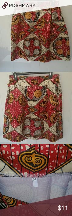 Ethnic print skirt This skirt has only been worn a few times. It has many days ahead of it. It has a small rip by the waist shown in the last two pictures. Other than thay there are no stains or tears. It comes from a smoke-free home. Skirts