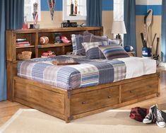 Small Bedroom For Boys with Rustic Wooden Storage Drawers Platform Bed also Wooden Floor and Wooden Bookshelf Headboard Set and Cool Blue Curtains also Wood Bedside Table Idea
