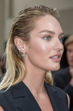 Candice Swanepoel attends the Dior Homme and combined the Dior tribal earring with other earrings - Effortless or too much - I am uncertain!