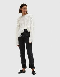 Cropped sweater from Which We Want in Ivory. High round neckline. Wide V back. Exaggerated drop shoulders. Long sleeves. Wavy hem. Frayed edges. Boxy silhouette. Oversize fit.  • Acrylic Knit • 70% acrylic, 30% polyester • Hand wash cold, line dry