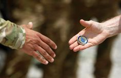 Interesting story about military challenge coins and drinking game associated with them.