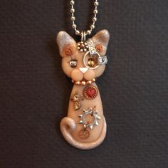 Steampunk Sphynx Kitty Cat Necklace Polymer Clay Jewelry. $22.00, via Etsy.