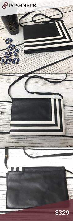 "VALENTINO Black White Stripe Crossbody Bag VALENTINO Black White Stripe Crossbody Bag. Gorgeous vintage piece! A perfect mix of trendy and sporty. Minor leather scuffs throughout that have been remoisturized. Vintage look and feel. Measures 7 inches tall and 10 inches wide. Strap drop is 19.5"". More pics available on serious inquiries only. Valentino Garavani Bags Crossbody Bags"