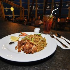 "Its always have a place for Asian Delight! This ""Chicken Pad Thai"" will fulfill it only with 60K. Accompany-ing with Iced Tea for this late dinner and off course with the marvelous view from 20th floor of @astonmakassar  #on20makassar 