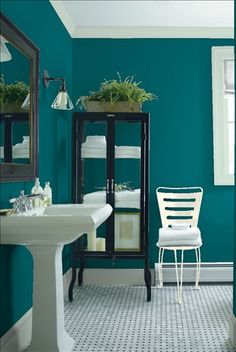 Look at the paint color combination I created with Benjamin Moore. Via @benjamin_moore. Wall: Pacific Ocean Blue 2055-20; Trim: Serene Breeze 449; Chair: Easter Lily 2150-70.