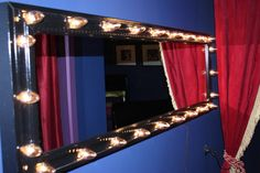 """Broadway themed girls room, Broadway themed room with dramatic flair comes to life with deep blue walls, smoky black ceiling and eggplant trim. Velvet curtains also add a touch of glamour to the space. , Hand made """"star"""" mirror with christmas tree lighting!  , Girls Rooms Design"""
