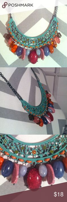 Cute colorful Necklace A very cute and homely necklace!! Has no marks whatsoever and in excellent condition!! Has colorful faux rocks and stones!! One of a kind!! Has gorgeous sparkly red middle stone in necklace set!! Jewelry Necklaces