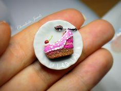 """Dollhouse miniature cake, shoe shaped cake ,inspired by the """"shoebakery""""  ,handscuplted of polymer clay ,in one inch scale ,by Chocoholic jewels"""