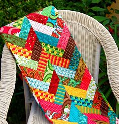 Combine strips from your jelly roll to make an impressive braided design that will look great in so many places. A jelly roll quilt pattern like this can be a table runner, a throw, or more depending on size.