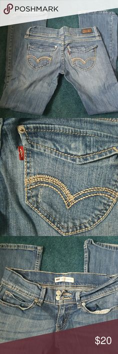 Women's Levi's jeans Super cute low rise jean. These are used but worn very minimally. Hidden snap detail on back pockets. Factory wear on front of the legs.Note they are junior sizing. Levi's Jeans Boot Cut