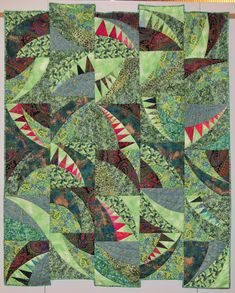 Borealis Quilt by Ruth Stegmeyer, started at a workshop with Pam Dinndorf (Aardvark Quilts)  in  Minnesota.  Machine paper pieced & machine quilted.  2012 Fine Art of Fiber exhibit.