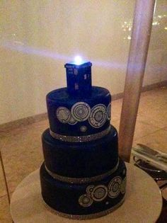 Doctor Who wedding cake with TARDIS topper.  Cute!