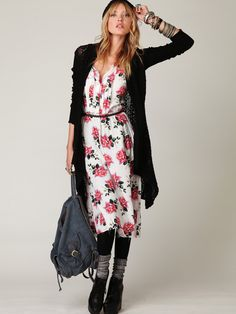 ...pintuck details, sweet floral print, long black cardi, and black tights/boots.  Love.