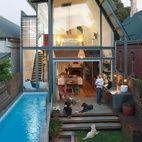 The Victorian facade of an 1880's bungalow in Adelaide, Australia, belies the modernity of its addition and spacious backyard, constructed during a renovation that filled the home's interior with natural light. Photo by James Knowler.