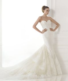 The New Design Tulle dress with bodies and skirt covered with lace. Mermaid dress with strapless sweetheart neckline, bare shoulders and sheer back. Wide skirt with a train of frills.  Free Measurement