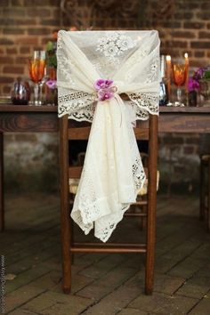 Décoration de chaises... lace on a chair tied with a flower...beautiful and unique wedding idea! LUV vintage weddings...<3