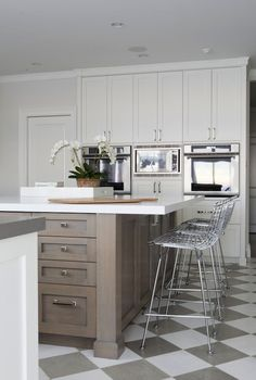 Check if Cambria!  Foley & Cox: Modern two-tone kitchen design with white & gray checkered tiles floor, walnut kitchen, quartz countertops