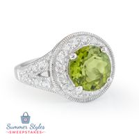 No matter where your vacation may take you, you'll always make a splash with the stunning peridot ring! || 3.73ct Round Manchurian Peridot™ With .94ctw Round White Zircon Sterling Silver Ring