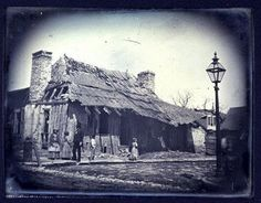 The house where Meriwether Lewis, William Clark, and Julia Hancock lived in St. Louis, shortly before it was torn down in the 1850s. Located on the corner of Spruce and Main, it was home to two other territorial governors, James Wilkinson and Alexander McNair. Courtesy Missouri Historical Society.