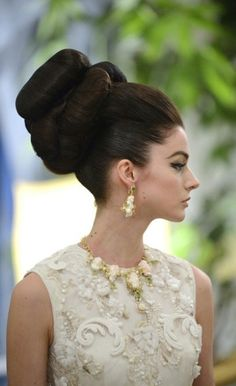60s meets 18th century big hair ... Love it, but one does wonder: does she have a headache?