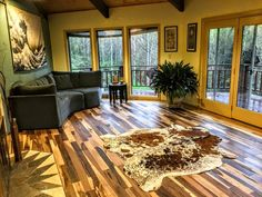 """""""Replacement of old stained white carpet with this beautiful wood. The room is bordered with Hickory with a field of Brazilian Pecan."""""""