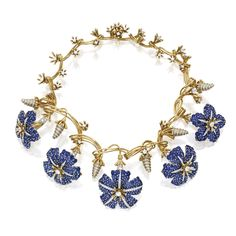 18 Karat Gold, Platinum, Sapphire and Diamond 'Morning Glory' Necklace, Schlumberger for Tiffany. The front suspending five fanciful flowerheads set with numerous round sapphires, spaced by sculpted flower buds, set with round diamonds, length 16 inches, signed Tiffany & Co., Schlumberger Studios, scratch number 16572543. With signed and fitted box.