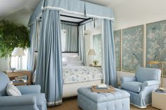 Pale blue canopy bed
