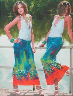 Юбка спицами в стиле пэчворк  Оригинальная вязаная юбка спицами 44/46 размера выполненная в технике пэчворк. Эта необыкновенная яркая юбка смотрится очень индивидуально и неотразимо. Пэчворк в данной юбке смотрится красочно и насыщено, но автор на этом не остановился, украсив низ юбки вышивкой с аппликацией из цветов.