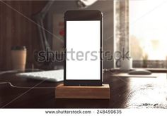 stock-photo--d-rendering-of-phone-on-table-248459635.jpg (450×316)
