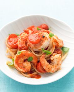 Canned diced tomatoes and fresh cherry tomatoes make a richly flavored sauce for linguine. Sweet shrimp and lots of fresh basil add brightness to this easy main dish.