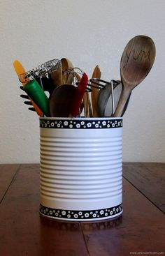 Upcycle a large can into a shabby chic tin can utensil holder.